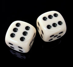 A photo of two six-sided dice on black background. The dice are white with black dots, and have the six result facing upwards.