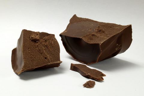 A photo of a piece of chocolate, broken in half