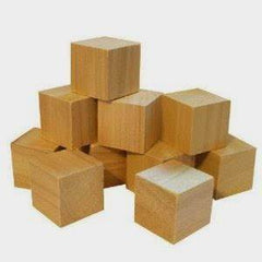 A photo of several plain wooden cubes, stacked in a small pile, against a white background