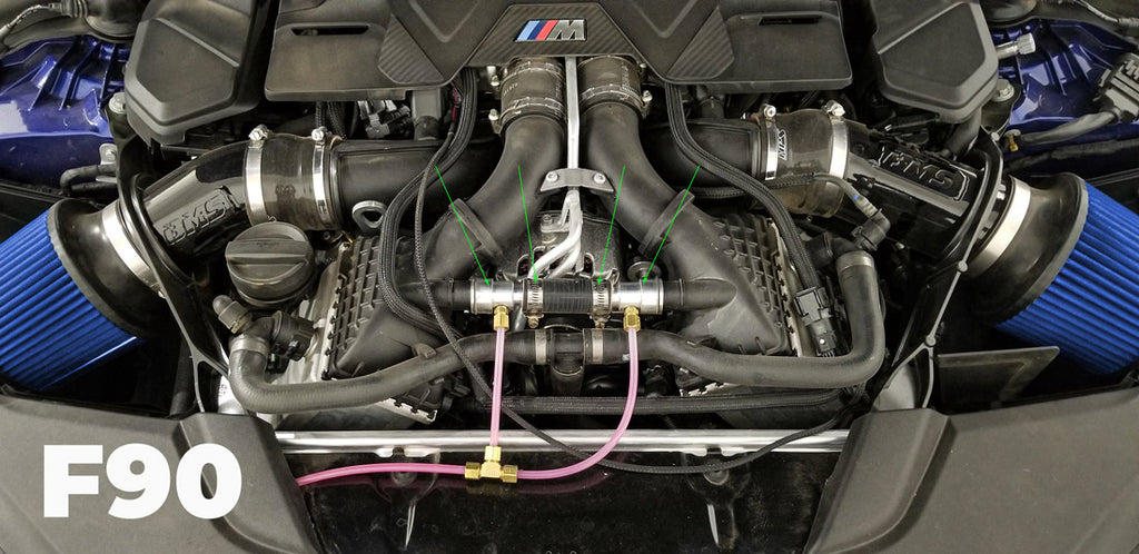 F90 BMW M5 water injection nozzles and adapters in place
