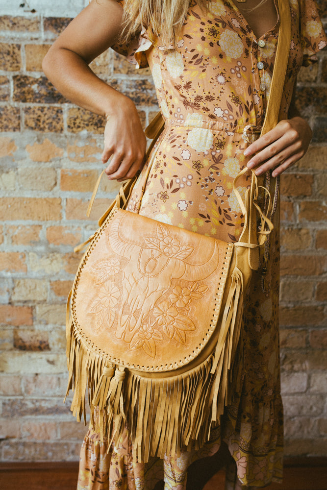 accross the body modern boho fringed leather cow skull and floral design bag
