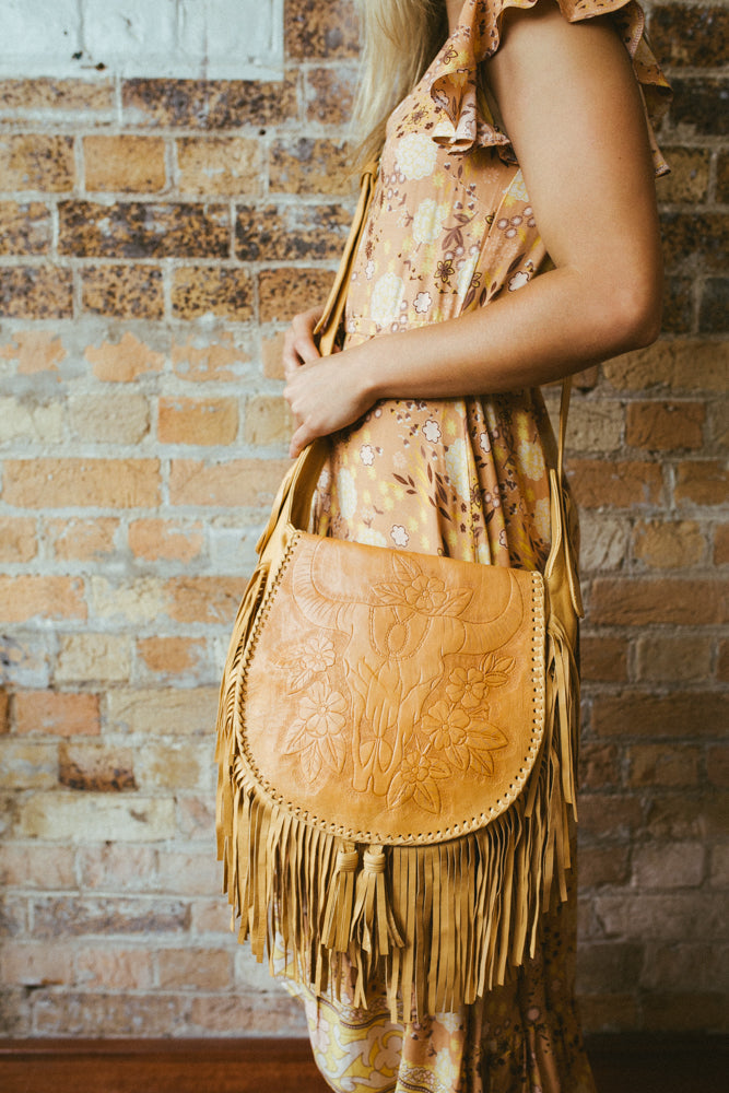modern boho fringed leather festival bag in tan colour