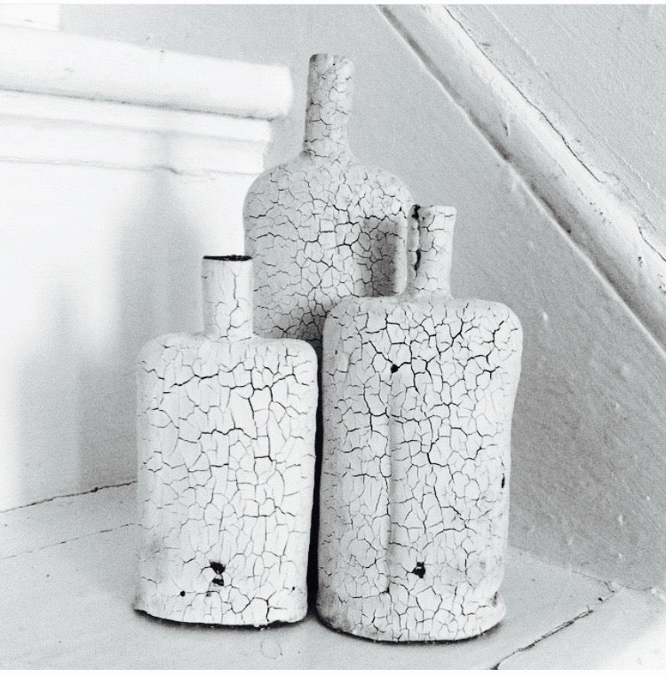 Raffaella Molin: Small cracked decorative bottles