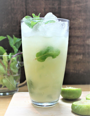 Virgin Apple Mojito, with pressed apple juice and mint sprigs. Perfect for a garden party