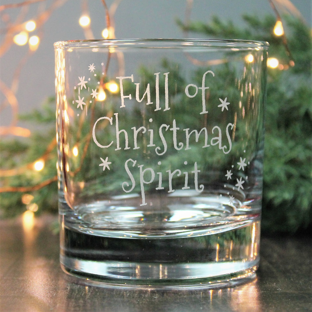 Whisky tumbler glass engraved with the words - full of Christmas spirit.