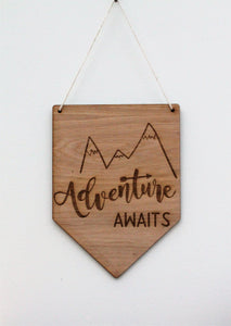 Adventure Awaits Sign