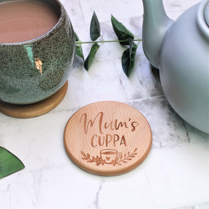 engraved wooden caoster for tea loving mum, engraved with the text mums cuppa with a floral design and tea cup