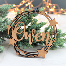 wooden personalised name bauble with star decoration, with a cut out design
