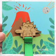 wooden dinosaur bookmark for child with green ribbon