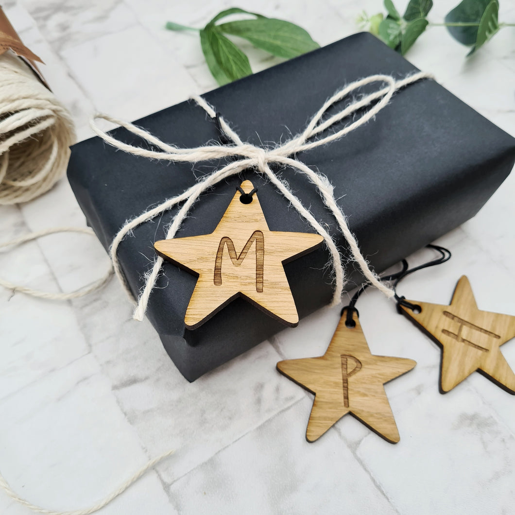 Star shaped gift tags engraved with the initial of your choice can also be used as decoration too