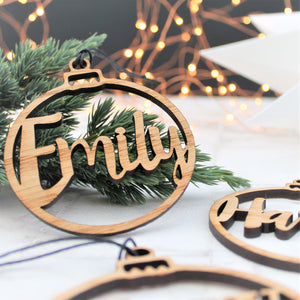 Christmas tree decoration with a custom name made from wood laser cut out