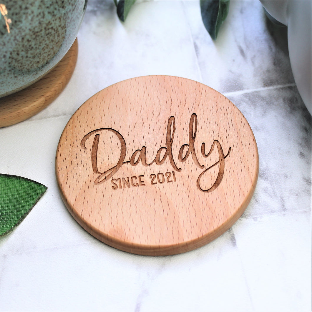 personalised daddy coaster, engraved on a round wooden disk. Perfect for fathers day