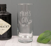 Engraved highball glass with engraved wording mum's gin. With a floral design it would be an ideal mothers day gift