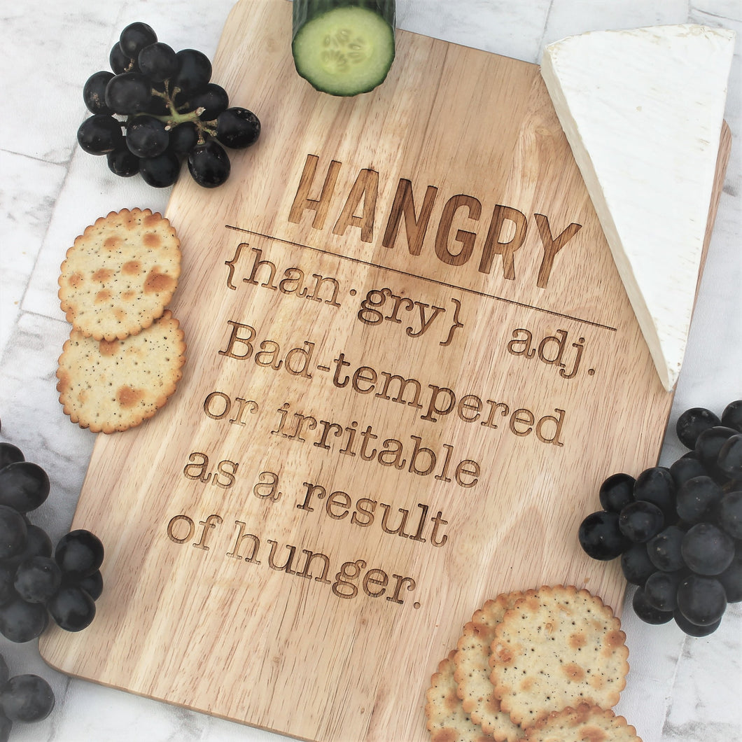 Engraved wooden chopping board with the definition of hangry on it