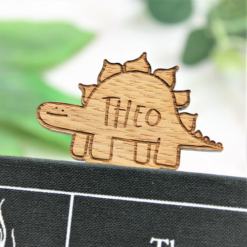 wooden engraved personalised name dinosaur bookmark with green ribbon