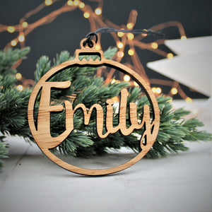 Personalised Christmas ornament with cut out name. Perfect for decorating the Christmas Tree