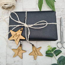Personalised star shaped gift tag, made from wood and engraved with the initial of your choice