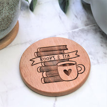 wooden books and tea coaster engraved round