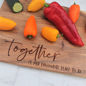 Wooden serving board engraved with the phrase together is my favourite place to be