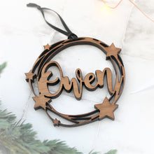 personalised name bauble made from wood with a cut out star design