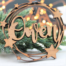 Wooden bauble with star design, personalised with a name, laser cut