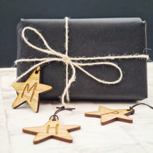 wooden gift tag personalised with initials of your choice shaped like a star