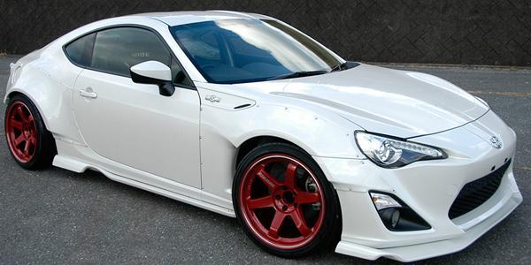 "Volk TE37RT 5x100 18x10.0"" +44mm Offset Burning Red Wheels"