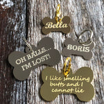 gold and silver bone dog tags