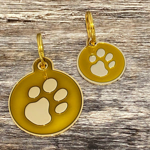 Gold enamel paw print dog tag