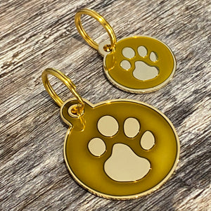gold paw print dog tag