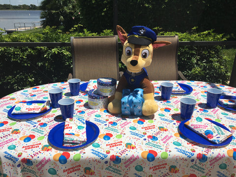 Chase from Paw Patrol is on the case with Happy Birthday Tablecloth by CelebrationTablecloths