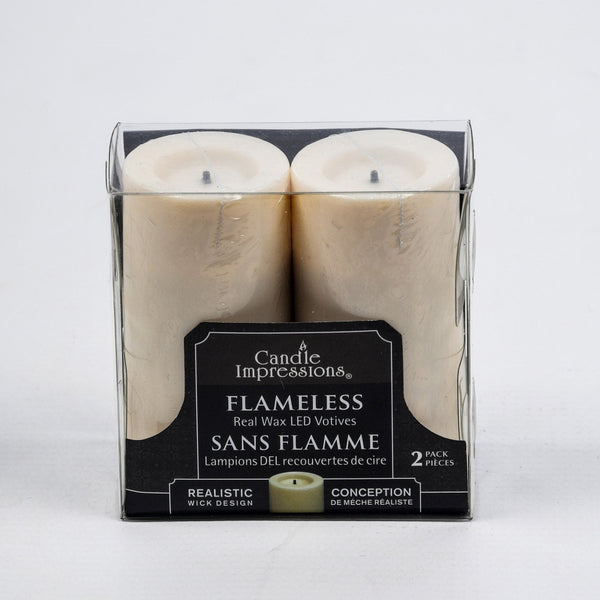 4 inch Battery operated Votives flickering Flameless Candles Real Wax pack of 2 - These were in John Lewis in 2017