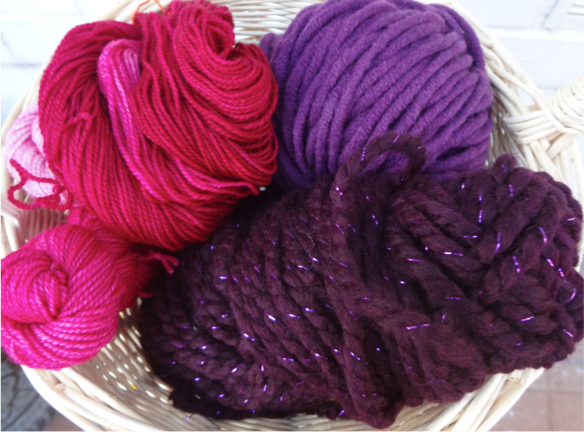 Pictured clockwise from back right: Rico Designs Essentials BIG 50% wool 50% acrylic, Lion Brand Wool Ease Thick and Quick Metallic 79% acrylic, 20% wool, 1% metallic Poly, Dragonfly Fibers Sock (4-1oz skeins, gradient colors) 100% superwash merino wool