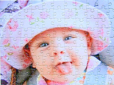 500 piece custom puzzle cut showing family photo of baby as a jigsaw puzzle
