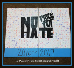 high school project students sign white puzzle pieces for bulletin board.  school fundraiser with puzzle