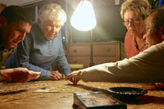 senior citizens with alzheimers and dementia assembling a jigsaw puzzle