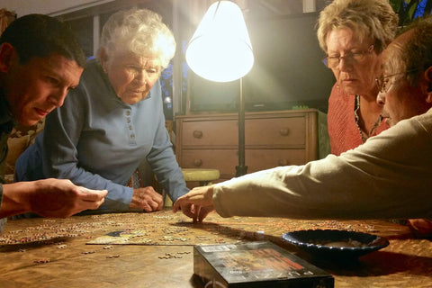 dementia patients working together to complete jigsaw puzzle - The Missing Piece Puzzle Company