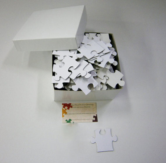 White Puzzle Pieces for wedding guest book.  Large puzzle pieces that are white.  The Missing Piece Puzzle Company