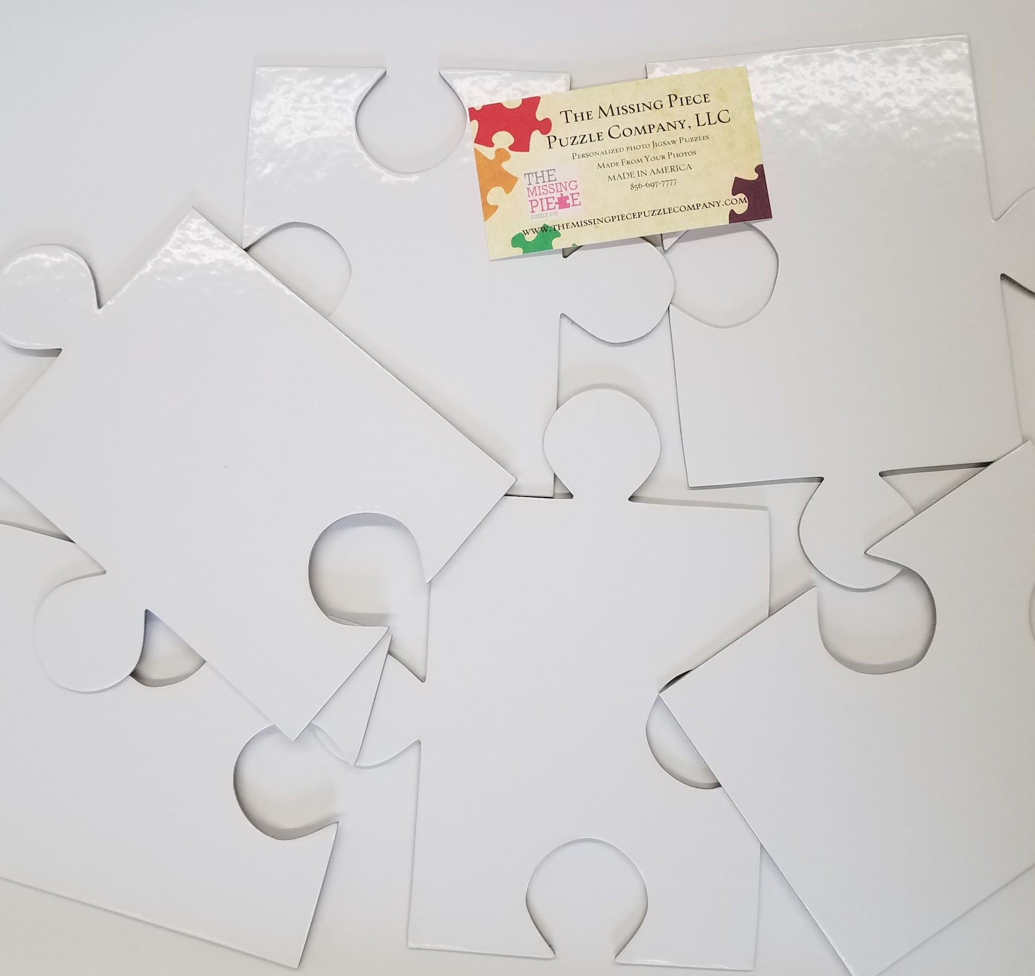 white puzzle pieces that are large for classroom project