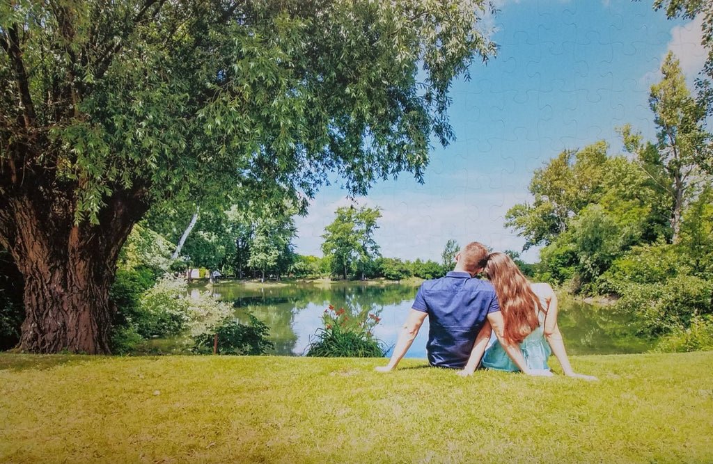Custom Wedding Guestbook Jigsaw Photo Puzzle cut with couple sitting by pond gazing at water.  The Missing Piece Puzzle Company