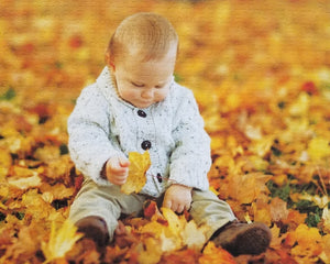 picture into a puzzle of baby in leaves.  500 piece puzzle - The Missing Piece Puzzle Company