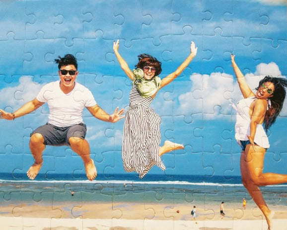 custom puzzle gift cheap.  Three people jumping on the beach with smiles - The Missing Piece Puzzle Company