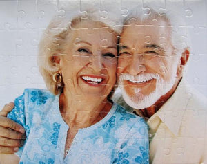 Retirement gift unique.  Retired couple hugging on a custom puzzle with 500 pieces.