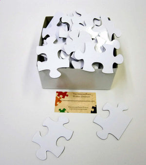 White Puzzle Pieces in a variety of piece counts.  Approximately 16x20 inches when complete.