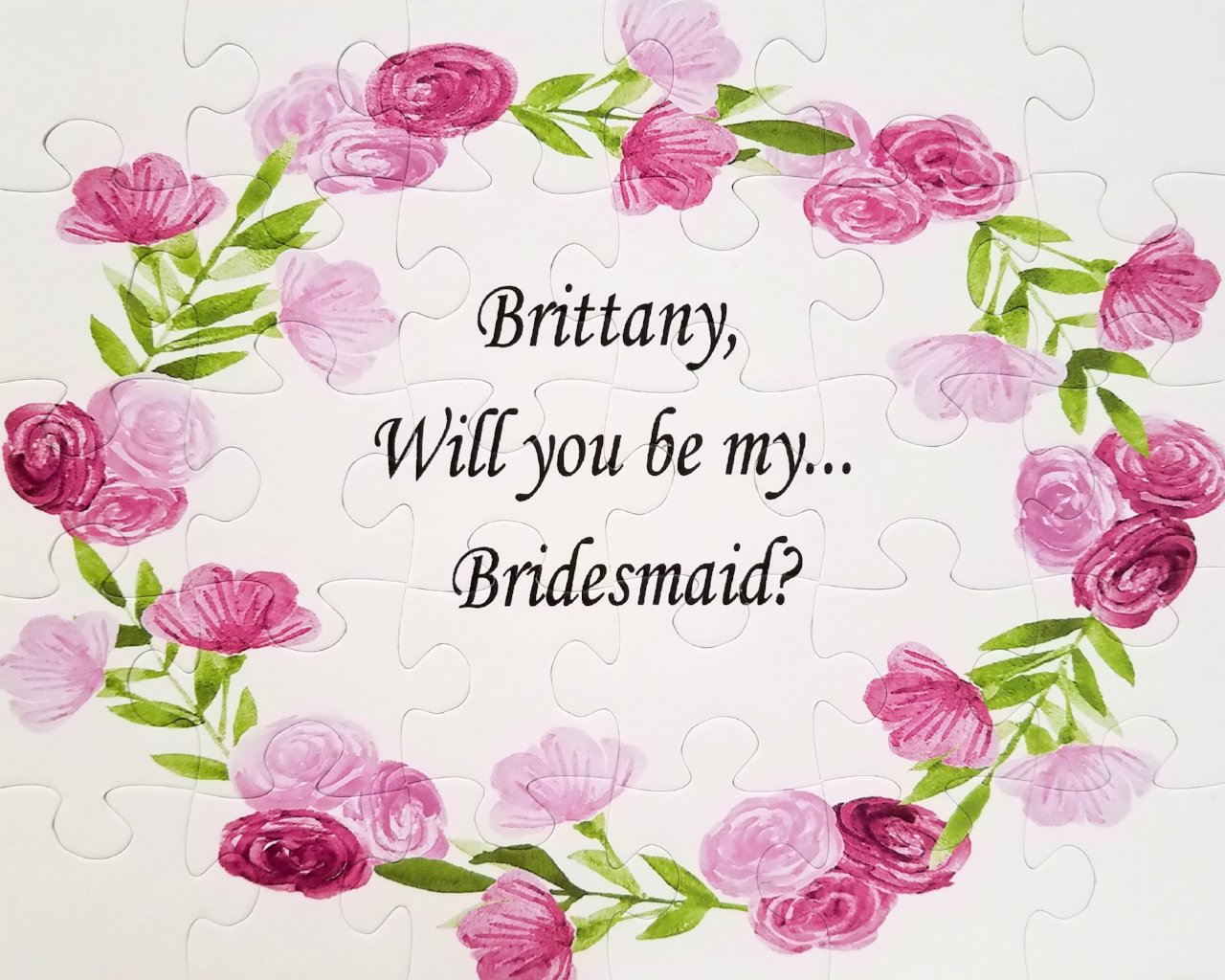 Ask your Bridesmaid, Flower Girl and Wedding Party to be in your wedding with a puzzle. Pink  puzzle with bridesmaids name. The Missing Piece Puzzle Company