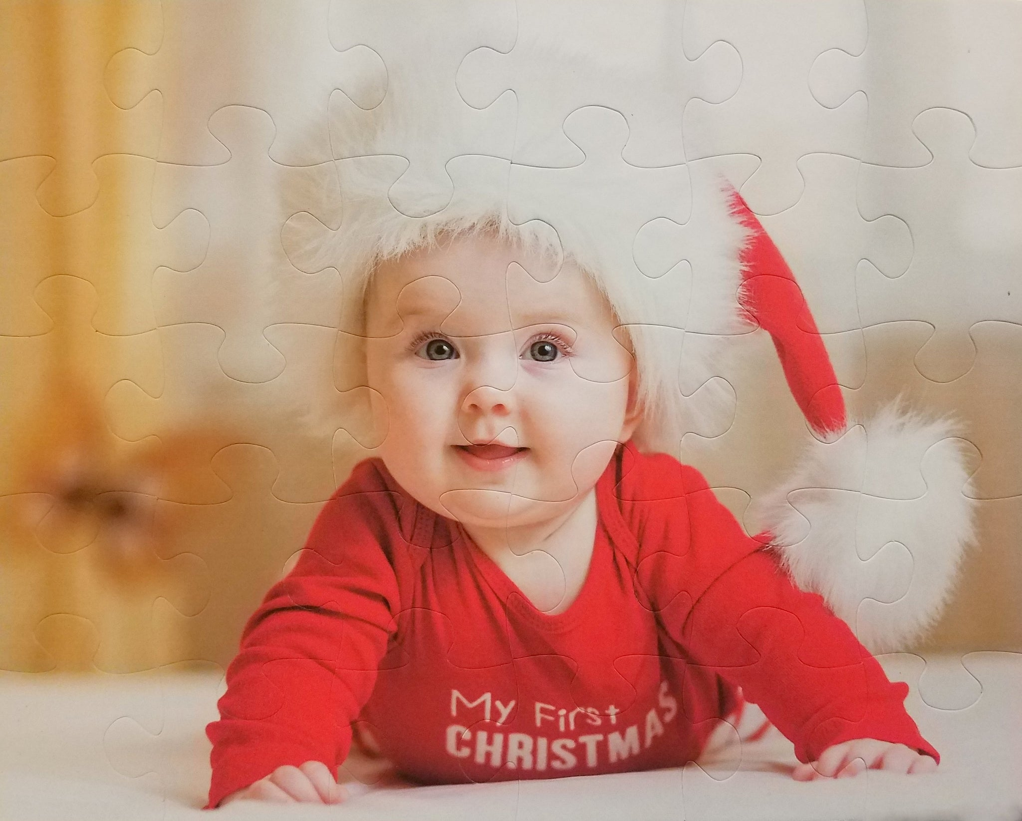 Custom photo jigsaw 8x10 with 30 big pieces for kids.  Baby with santa hat on a puzzle.  Big puzzle pieces in cheap puzzle that is made well.