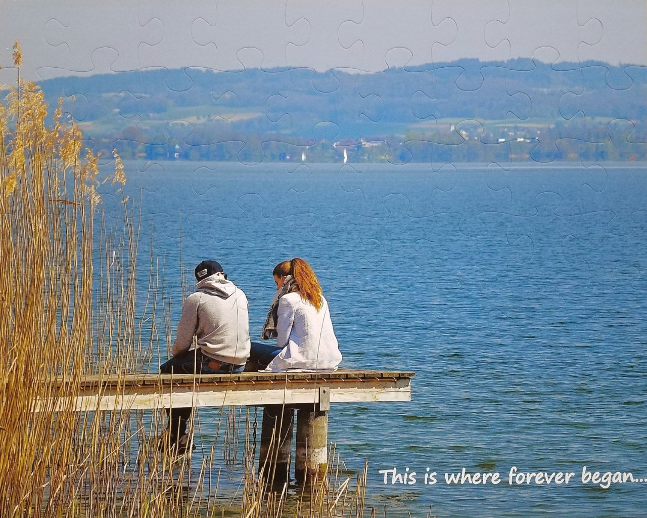 Wedding Guest Book Jigsaw Puzzle Pieces.  Blue photo of couple sitting on dock marriage proposal.  Marry Me proposal puzzle