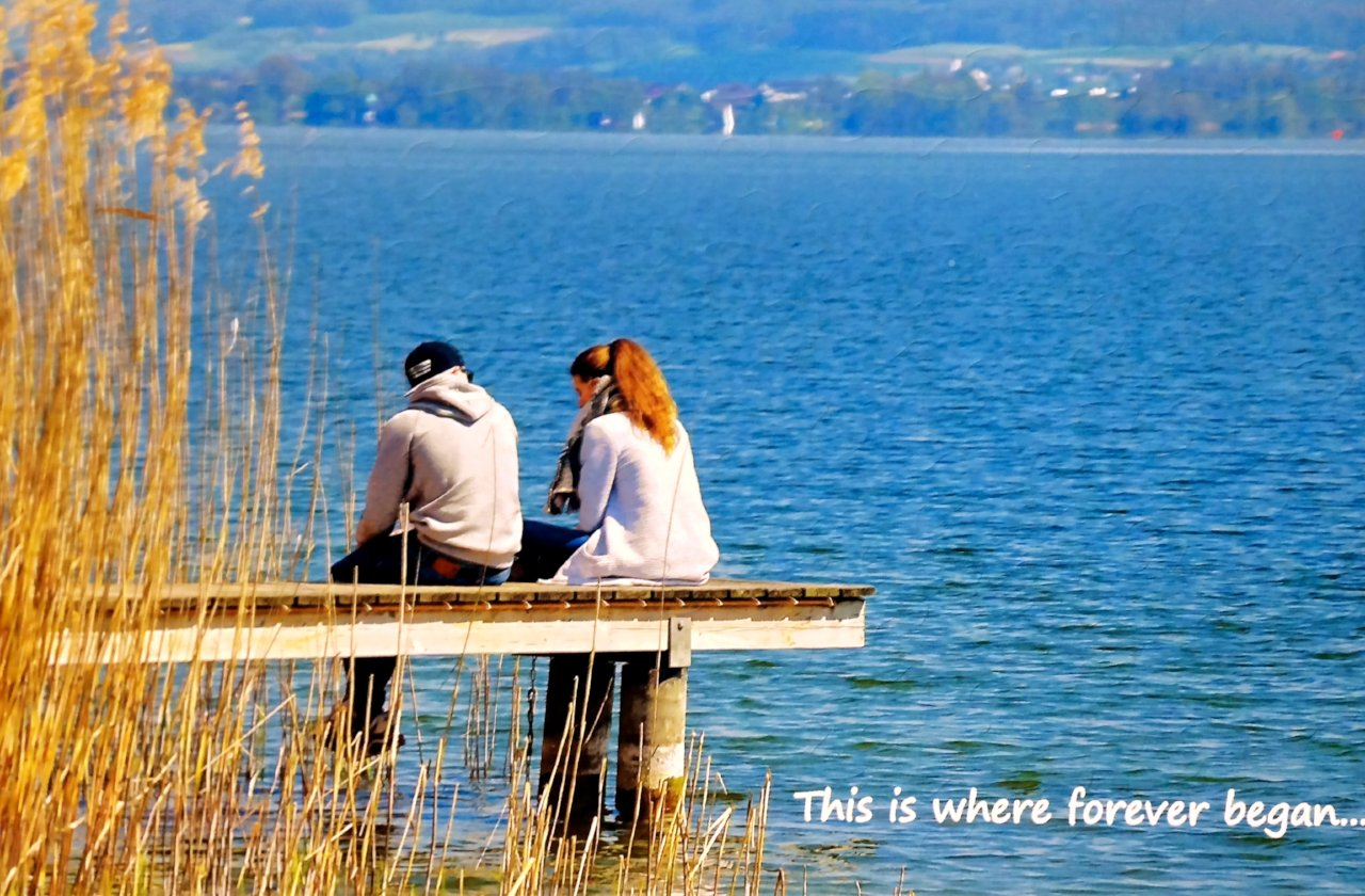 Newly Engaged couple sitting on dock. The photo is a jigsaw puzzle with date of wedding.