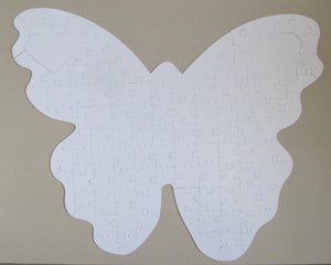 all white puzzle butterfly shaped