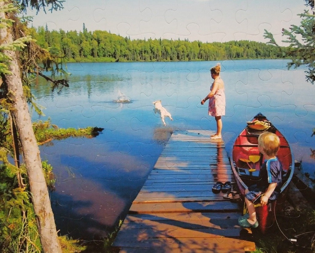 custom puzzle of dog jumping into lake off of deck - The Missing Piece Puzzle Company